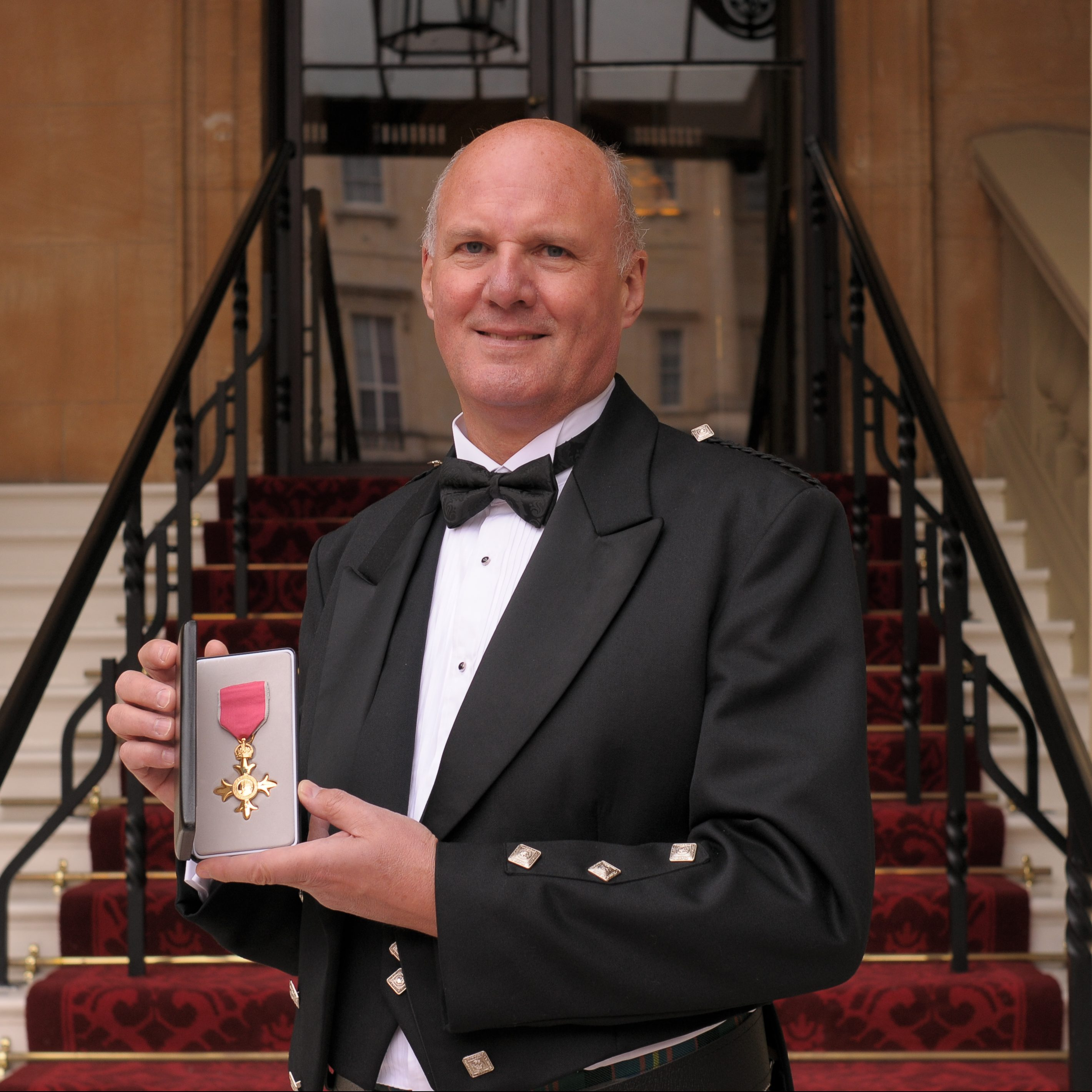 Donald Cameron receives his OBE at Buckingham Palace